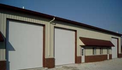 INDUSTRIAL SECTIONAL OVERHEAD DOORS IN DUBAI from ARABIAN GULF DOOR EST