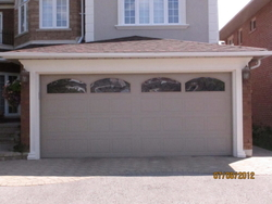 RESIDENTIAL GARAGE DOOR (SECTIONAL OVERHEAD) SUPPLIERS IN UAE from DESERT ROOFING & FLOORING CO L L C (DOORS DIVISION)