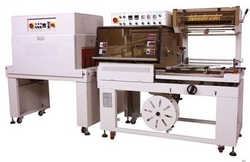 Shrink Wrapping Machine(L-Sealer,Tunnel) from TOTAL PACKAGING SOLUTIONS FZC /WWW.TOTALPACKGULF.COM