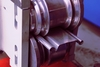 Rolling shutters slat forming machine